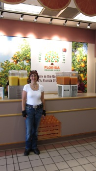 Enjoying fresh Florida orange juice at the State Information Centre