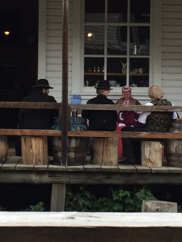 "The ""locals"" enjoying an afternoon visit on the veranda outside the General Store"