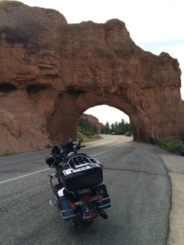 One of the two natural rock tunnels I rode through in Red Canyon